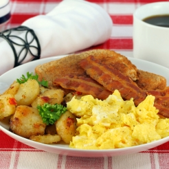 Eggs, home fries, bacon and toast for breakfast.