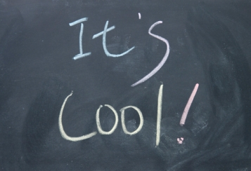 it s cool title  written with chalk on blackboard